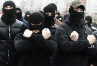 Russian ultra-nationalists march during a demonstration on the outskirts of Moscow